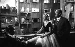 Hitchcock on the set with his stars.